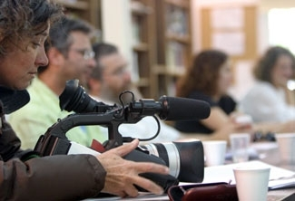 Filmmaker Yulie Cohen-Gerstel films her Jewish text study class at the Alma College in Tel Aviv on April 28. (Brian Hendler)