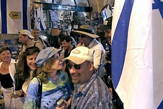 A group visiting Israel on a 10-day trip organized by JDate walk through the Old City of Jerusalem on May 9. (Brian Hendler)