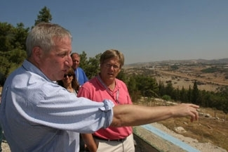 Jewish Council for Public Affairs vice chairman Geoffrey Lewis, left, and Reverend Bill Goettler, the minister of the First Presbyterian Church of New Haven, view Israel´s security fence near Kalkilya during a September 2005 interfaith mission. (JCPA)