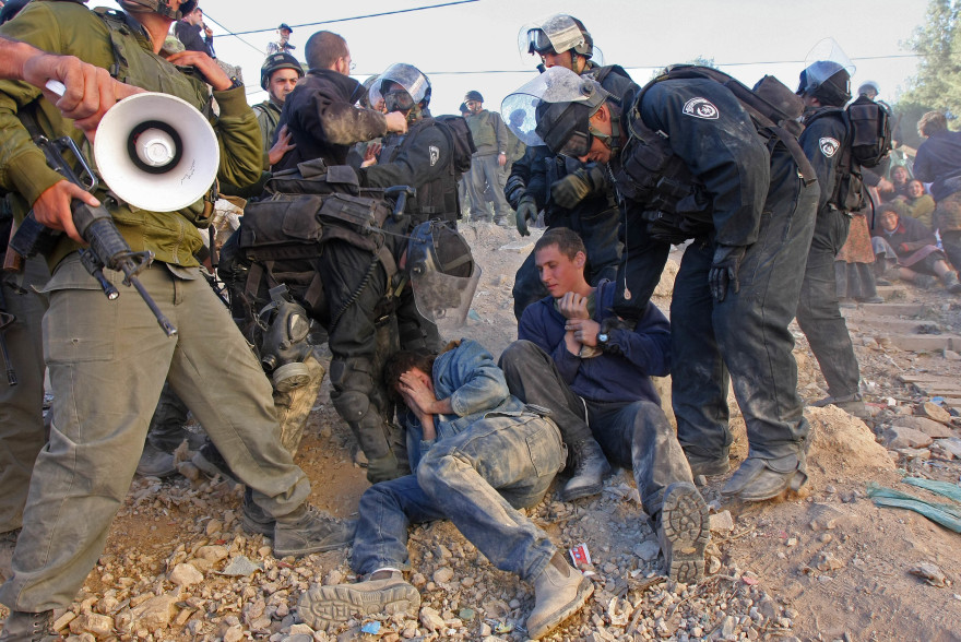 Young settlers clash with Israeli police during evacuation of a disputed Hebron house on Dec. 4, 2008. (Brian Hendler)