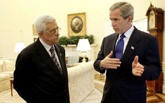 President Bush and Palestinian Authority President Mahmoud Abbas meet in the Oval Office, July 25, 2003. (White House )
