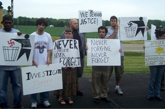 Demonstrators denounce Ted Junker at a rally in Sugar Creek, Wis. (Courtesy of Jonathan Brostoff)
