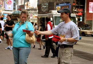 A Jews for Jesus missionary hands out leaflets in New York´s Times Square on July 2. (Courtesy Jews for Jesus )