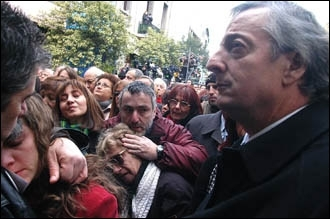Argentina has been more sensitive to Jewish concerns under President Nestor Kirchner. Kirchner, right, joins mourners on the tenth anniversary of the bombing of the AMIA Jewish center. (Argentine National Presidency)