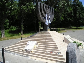The Holocaust memorial at Babi Yar was recently vandalized. A plaque in Hebrew and Ukrainian was badly damaged, as shown on this July 22 photo. (Vladimir Matveyev/JTA)
