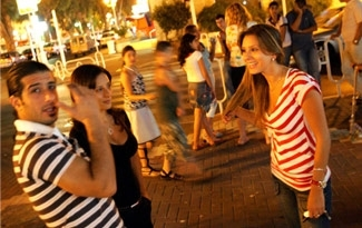 Israelis gather in the center of town for late night reunions as life slowly returns to normal, Aug. 15, in the northern Israeli border town of Nahariya. (BPH Images)