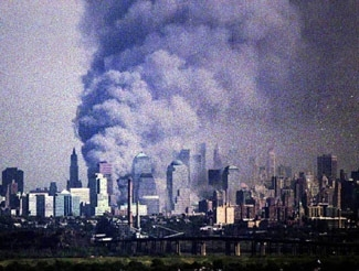 A plume of smoke rises from where the World Trade Center stood, on Sept. 11, 2001, as seen from New Jersey. (Robert A. Cumins)