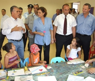 Education minister Yuli Tamir, holding flower, and JAFI officials visit a JAFI-supported community center in Majdal Krum.  (Mahsaan Nasser)
