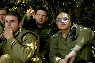 The IDF chief of staff, Dan Halutz, at right, reviews troop advances in southern Lebanon on Aug. 12, 2006 with officers commanding Israeli forces in that area. (Abir Sultan/IDF)