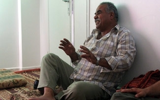 Mahmoud Yaghy, a Palestinian refugee, pictured in his home in Amman. (Uriel Heilman)