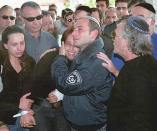 Ya´acov and Shiri Shefi embrace at their 5-year-old daughter Danielle´s funeral, a day after she was shot to death in her home by a Palestinian terrorist, in a Kiryat Gat cemetery April 28. (Brian Hendler)