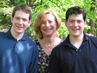 Dr. Dana Beyer, a transwoman who was raised Orthodox, with her two sons. ()