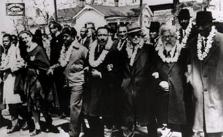 Rabbi Abraham Joshua Heschel, second from right front row, marches with Martin Luther King, Jr., center, in Selma, Ala., in March 1965. (Courtesy of Susannah Heschel)