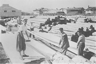 Italian Jews perform forced labor at a lumber mill in Gorizia, Italy, in 1942. (USHMM/Courtesy of Marcello Morpurgo)