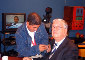 A station employee wires Nicaraguan Jewish Community vice president Gerald Smith with a microphone ahead of a Feb. 19, 2007, appearance on Channel 2 television's morning news program. (Brian Harris)