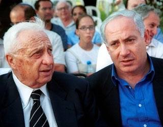 Prime Minister Ariel Sharon, left, sits with Likud Party leader challenger Benjamin Netanyahu at a local event in a file photo. (Brian Hendler)