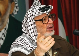 Palestinian leader Yasser Arafat speaks to members of the Palestinian legislative council May 15 in Ramallah, calling for reforms within the Palestinian Authority. (PPO/BP Images)