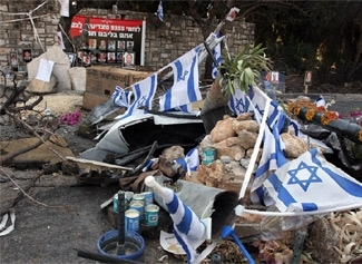 Israeli flags cover a memorial made to 12 soldiers killed by a direct hit in Kfar Giladi during Israel´s war with Hezbollah. (Brian Hendler)