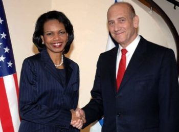Israeli Prime Minister Ehud Olmert shakes hands with U.S. Secretary of State Condoleezza Rice in Jerusalem, March 25. (Moshe Milner/GPO/BPH Images)