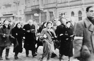 Jews are rounded up for deportation from the Warsaw Ghetto circa 1942. (USHMM, courtesy of Instytut Pamieci Narodowej)