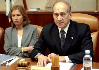 Israeli Prime Minister Ehud Olmert sits next to Foreign Minister Tzipi Livni during a Cabinet meeting in Jerusalem, at the start of last summer's war in Lebanon. (BPH Images)