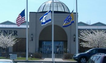 An American and Israeli flag fly outside a Jewish day school in Livingston, N.J. (Courtesy NJJN)