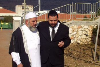 Sheik Mohammed Kiwan, left, imam of the town of Majed-El-Croum, and Rabbi Gavriel Va'aknin, right, of Carmiel, discuss interfaith dialogue among religious leaders in northern Israel. (Courtesy the Abraham Fund)