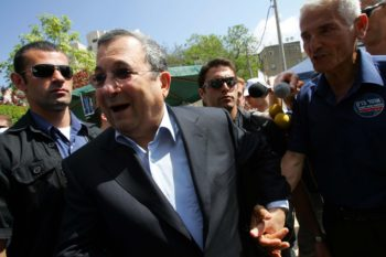 Ehud Barak is greeted by supporters as he arrives to vote in the second round of Labor Party primaries June 12, in Kfar Saba. (Brian Hendler)