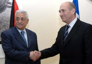 Israeli Prime Minister Ehud Olmert, right, and Palestinian Authority President Mahmoud Abbas meet at Olmert's official residence in Jerusalem on March 11.  (GPO / BPH IMAGES)
