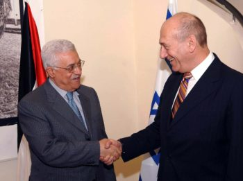 Israeli Prime Minister Ehud Olmert, right, greets Palestinian Authority President Mahmoud Abbas at Olmert's residence in Jerusalem on July 16. (GPO/BPH IMAGES)