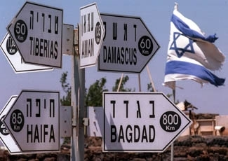 A signpost on Mount Bental in the Golan Heights, captured from Syria during the Six-Day War, showing cities and distances. Tehran is 1,000 miles from Tel Aviv, but only a few minutes by missile. (Brian Hendler)