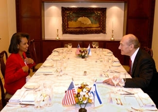 U.S Secretary of State Condoleezza Rice, left, dines with Israeli Prime Minister Ehud Olmert in Jerusalem, Nov. 4, 2007. Rice on Sunday launched a new round of efforts to bring Palestinian and Israeli negotiators closer to forging an outline for a final p (Matty Stern/ BPH IMAGES)