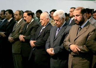 Palestinian president Mahmoud Abbas (second from right) attends Friday prayers with Hamas delegates including Nasseredine al-Shaer, former deputy prime minister in the first Hamas   (THAER GANIM/PPO / BPH IMAGES)