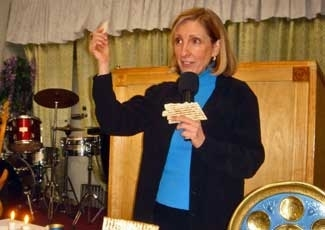 "Karol Joseph of Jews for Jesus gives an evangelical spin on the meaning of matzah at Living Springs Family Center, a storefront Pentecostal church in Brooklyn. Joseph gives the ""Christ in the Passover"" presentation at congregations across the United State (Barry Yeoman)"