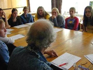 Non-Jewish Lithuanian girls listen as a visitor to their Jewish culture class, Jacob Bunka, the last Jew in their town, speaks. (Ezra Nathan)