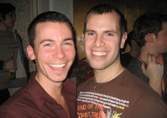 Bill Hughes, 25, left, and organizer Jayson Littman, 30, enjoying Jewfest, which is believed to be the first gay Jewish Christmas Eve party, at the Vlada lounge in New York City. ()