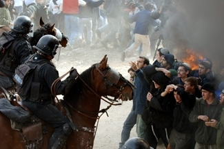 With President Bush pressing the point on unauthorized outposts and Israel saying it will be cracking down as early as next week, will clashes like this one in 2006 at Amona between police and protesters be repeated? (Avi Ohayon/GPO)