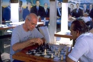 Cuban exiles play chess at Maximo Gomez Park in Miami's Little Havana neighborhood, a hotbed of anti-Castro sentiment in South Florida. (Larry Luxner)