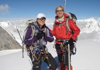 Nikki Bart, left, and her mother, Cheryl, stand atop Cho Oyu in Tibet after conquering the world's sixth highest mountain last year.       ()