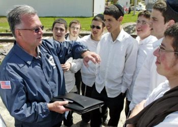 Students from the Yeshiva of Northeast Iowa in Postville gather across the street from Agriprocessors Inc. to ask questions of U.S. Immigration and Customs officials regarding the raid on May 12, 2008.  (Harry Baumert/Des Moines Register)