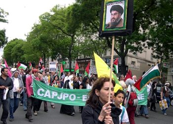 Marchers in a pro-Palestinian parade in Paris on May 17, 2008 chant anti-Zionist slogans while holding signs of Hezbollah leader Hassan Nasrallah.   (Dvorah Lauter)