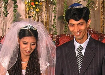 Isaac Divekar and his bride Siyona Garsulkar, two young professionals who intend to remain in India, at their wedding reception in Mumbai.  (Ben Frank )