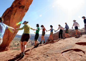Adventure Rabbi participants dance under Corona Arch outside Moab, Utah, during a Passover seder led by Rabbi Jamie Korngold on April 19, 2008. (Jeff Finkelstein)
