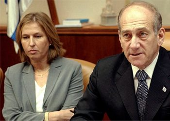 Israeli Foreign Minister Tzipi Livni, seated next to Ehud Olmert at a Cabinet meeting, is a leading contender to succeed the prime minister. (BPH Images/JTA)