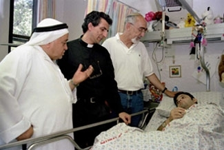 In a trip organized by Rabbis for Human Rights, a group of interfaith clergy visit bombing victim Sharon Mamon in a Jerusalem hospital. (Avi Hanun)