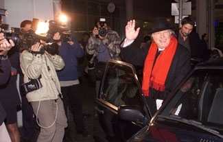 Nobel Prize winner Imre Kertesz is greeted by the press Oct. 16 in Budapest.  (Bence Kovacs)