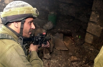 An Israeli soldier searches the hiding place of Islamic Jihad military commander Iyad Sawalhe in the early morning of Nov. 9 in Jenin. (IDF/BP Images)