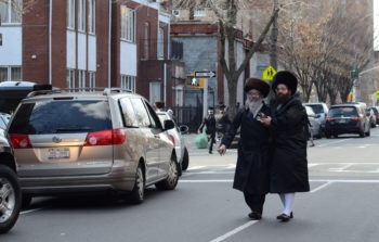 Two Chasidic men walk in Williamsburg, Brooklyn. Along with Borough Park, the neighborhood accounts for two-thirds of overall Jewish population growth in the New York area, according to new details from a 2012 study.  (Gedalya Gottdenger via Creative Commons)