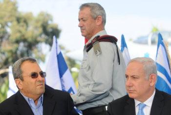 Israeli military chief Lt.-Gen. Benny Gantz walks by Prime Minister Benjamin Netanyahu, right, and Defense Minister Ehud Barak at an arrival ceremony for freed Israeli soldier Gilad Shalit at the Tel Nof Air Force base, October 2011. (Yossi Zeliger/FLASH90)