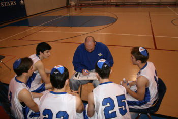 Chris Cole, coach of the boys basketball team at the Robert M. Beren Academy in Houston, offering up some strategy for his squad. (Samantha Steinberg )